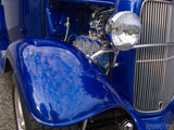 vintage blue ford truck fender closeup