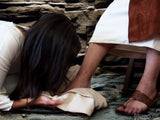 woman weeps at the feet of jesus