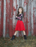 Versatile black floral leotard paired with a red twirly skirt.