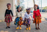 African Print Skirt and Head Wrap. Girl's modeled different African prints.