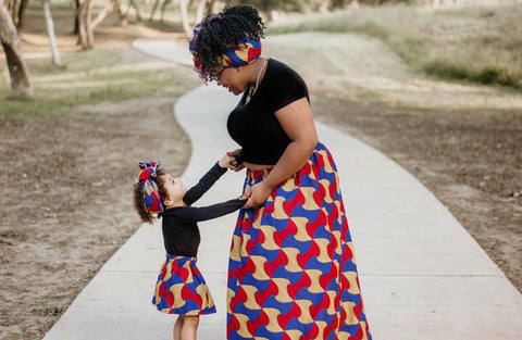 Maxi length bow African print mommy and me matching skirt set.