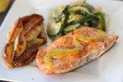 Creole Mustard Glazed Salmon, Sautéed Zucchini & Roasted Garlic Potato Wedges