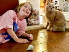 Whitney and Huckle with Garlic Cat Toy