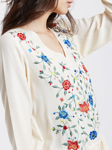 Beautiful ivory long sleeve floral embroidered blouse with drawstring waist great for work or casual wear