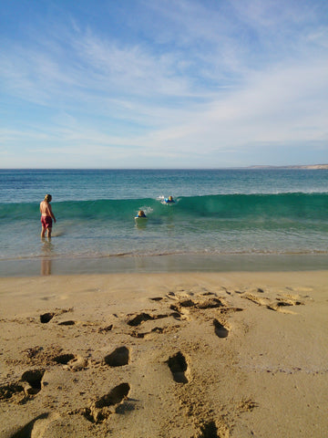 Boys having a quick surf after school, Coles Point, NutWare Loose Wheel Nut Indicators