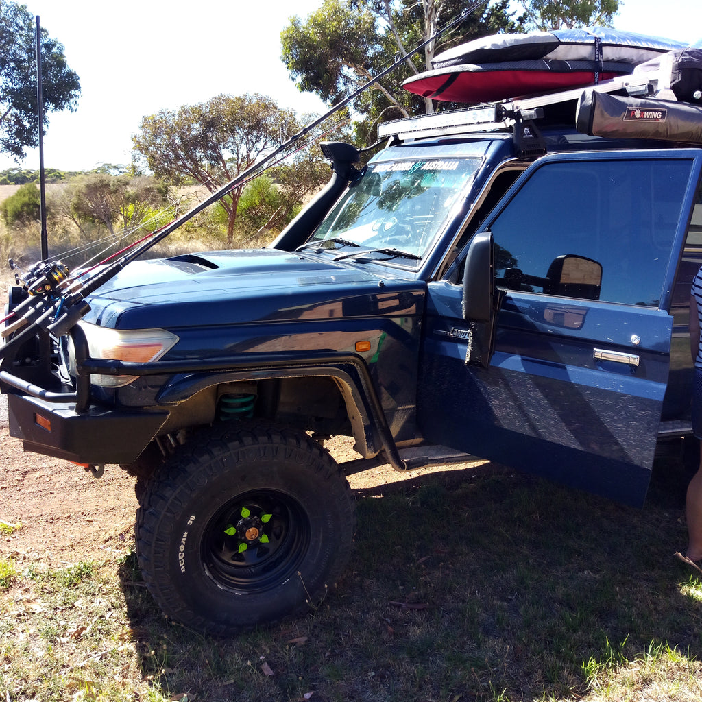 Land Cruiser Troopie with Green NutWare, the Kimberly Camper Trailer with Orange Wheel Nut Indicators. Australian Made, mixed bag of 100 Colours and Sizes.