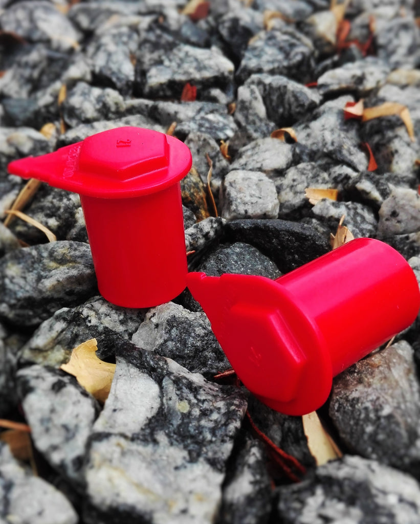 Red extended wheel nut indicators for 4wds caravans and trailers. Aussie made, wheel safety.