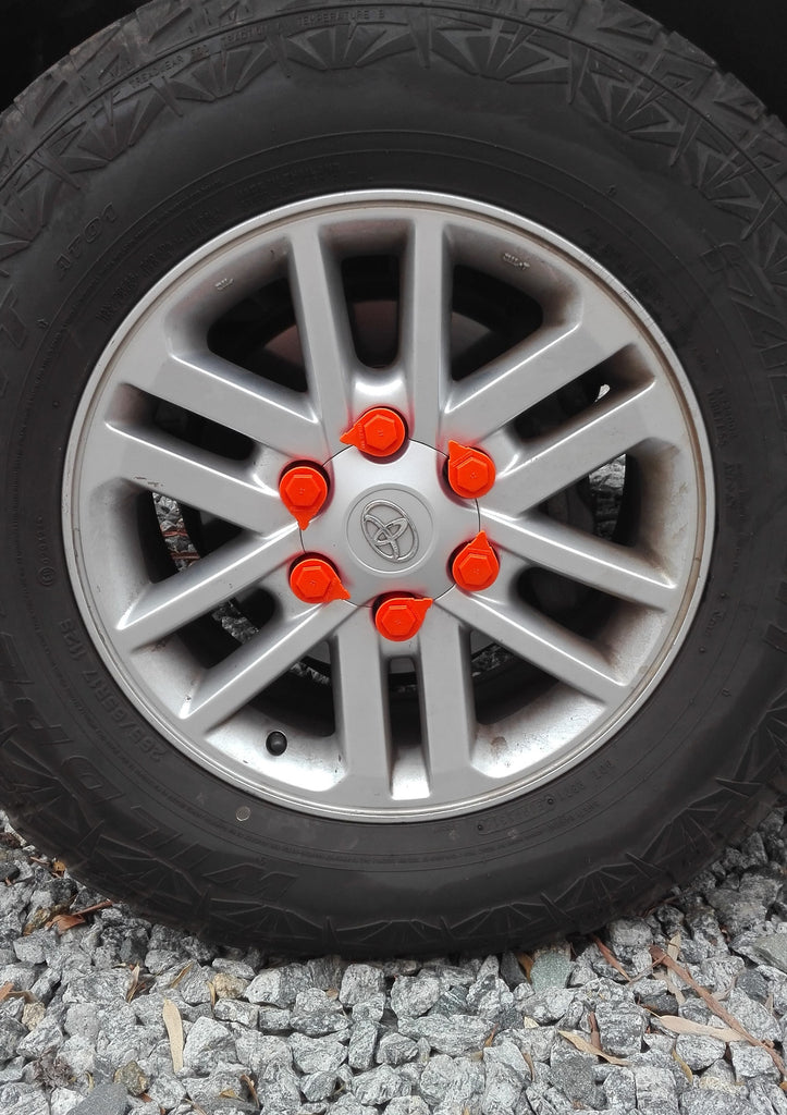 Orange Loose Wheel Nut Indicators on a Chrome Rim from the NutWare Colour range