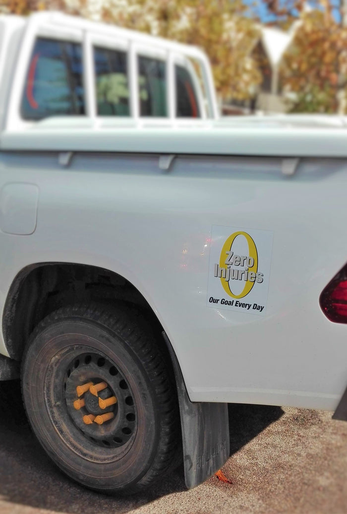 The Australain Made Yellow Loose Wheel Nut Indicator on the Hilux Ute - NutWare