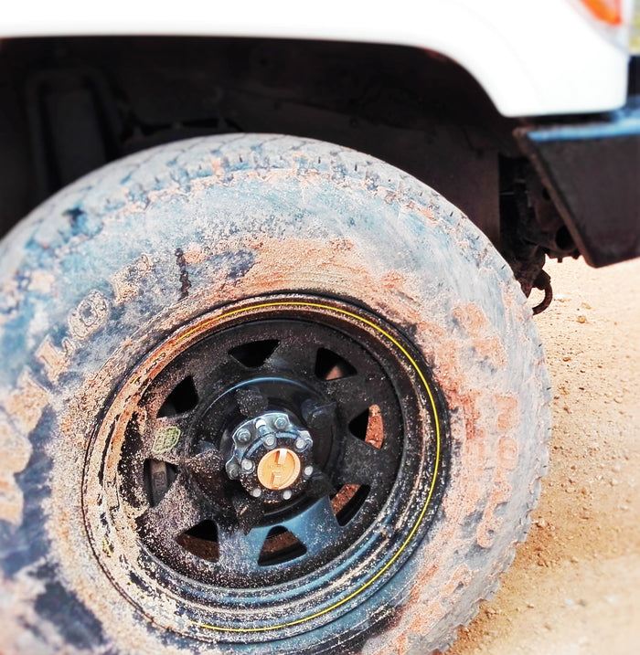 Our Black Loose Wheel Nut Indicators - Muddy but the wheel nuts are as new underneath.