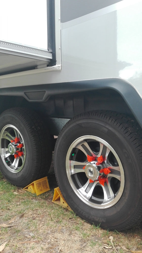 The Jayco Silverline Caravan, with slide-out, chocked and fitted with Australian Made NutWare, Loose Wheel Nut Indicators. The safety conscious owner has gone with orange, for a quick and easy visual alert of excessive heat and loosening or lost wheel nuts.