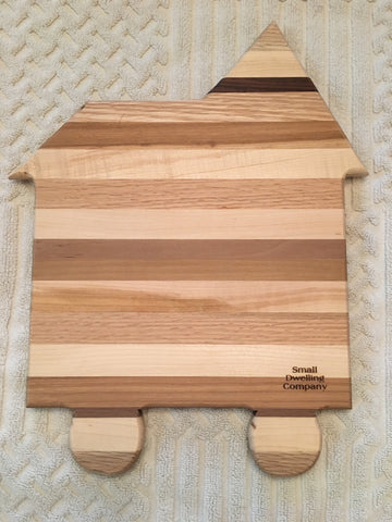 Recycled wood cutting board in the shape of a tiny house. The perfect gift for the tiny home owner
