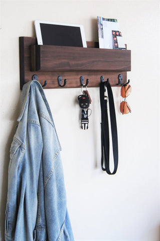 Handmade Mail Holder with Coat and Key Hooks with walnut stain. Available through Tiny House Depot