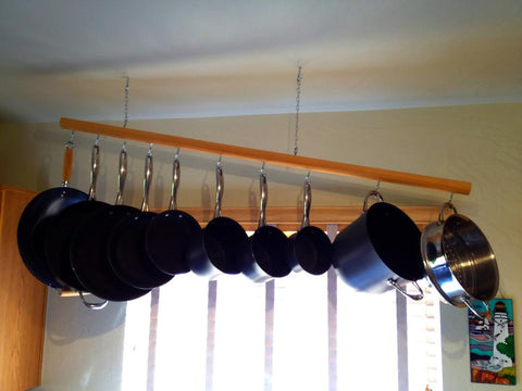 Handmade pot rack holds up to 10 hooks. Great organization for your tiny home. Available through Tiny House Depot