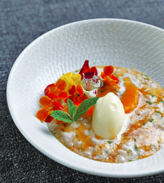 Prana Chai Rice Pudding with Orange Sauce and Sorbet