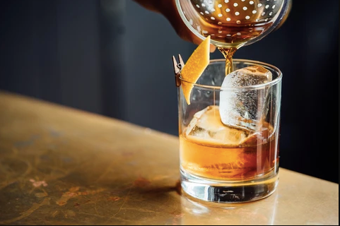 Chai Whiskey on The Rocks with an Orange Twist