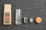 Flat lay Prana Chai Masala Blend & Glass Infuser Bottle