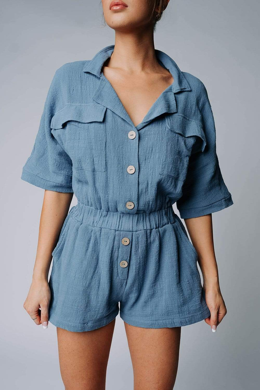 The Carter Romper in Dusty Blue
