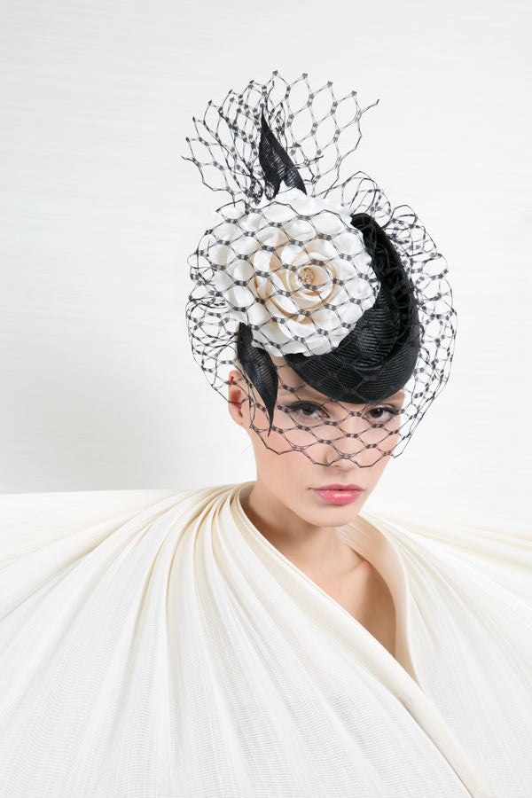 Philip Treacy Designer hat with black net veil