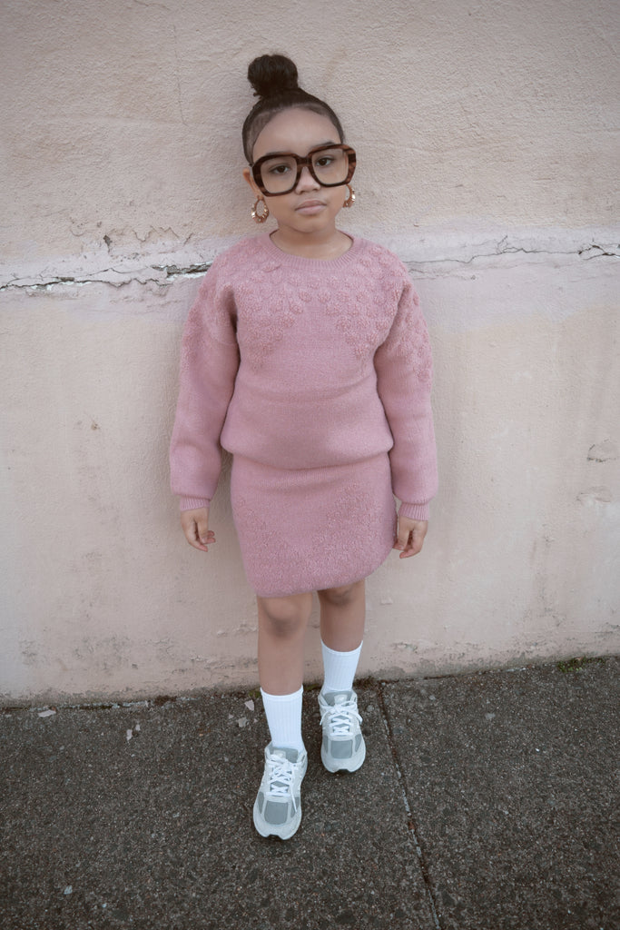 Plush pink sweater and skirt