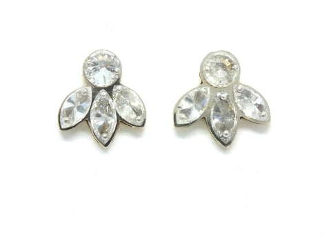 One Round Diamond with Three Marquise Diamond Studs