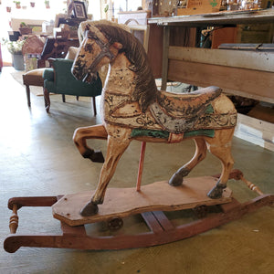 Antique wood rocking horse w/ cast iron wheels - distressed