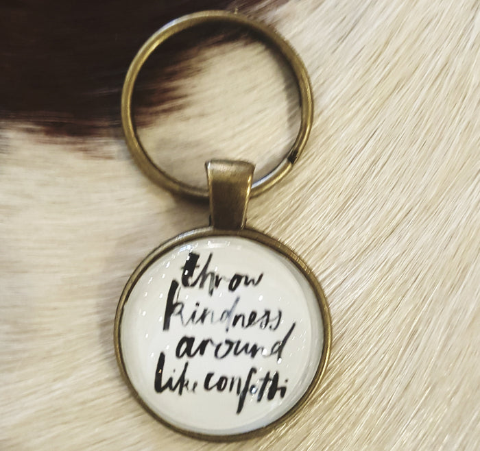 Throw kindness around like confetti - circle keychain