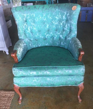 Vintage upholstered wingback chair with wood legs