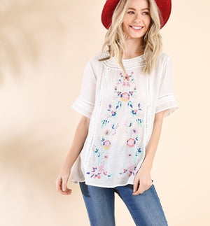 Floral embroidered top with crochet trim