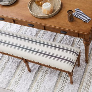 Wood bench with linen and nailhead trim