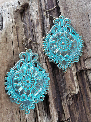 Turquoise medallion earrings handmade by Anni Frohlich