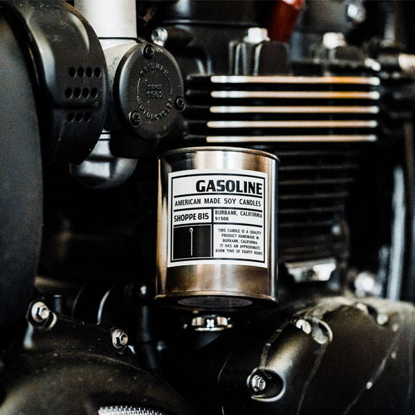 Tin Gasoline candle perched on a Triumph engine.