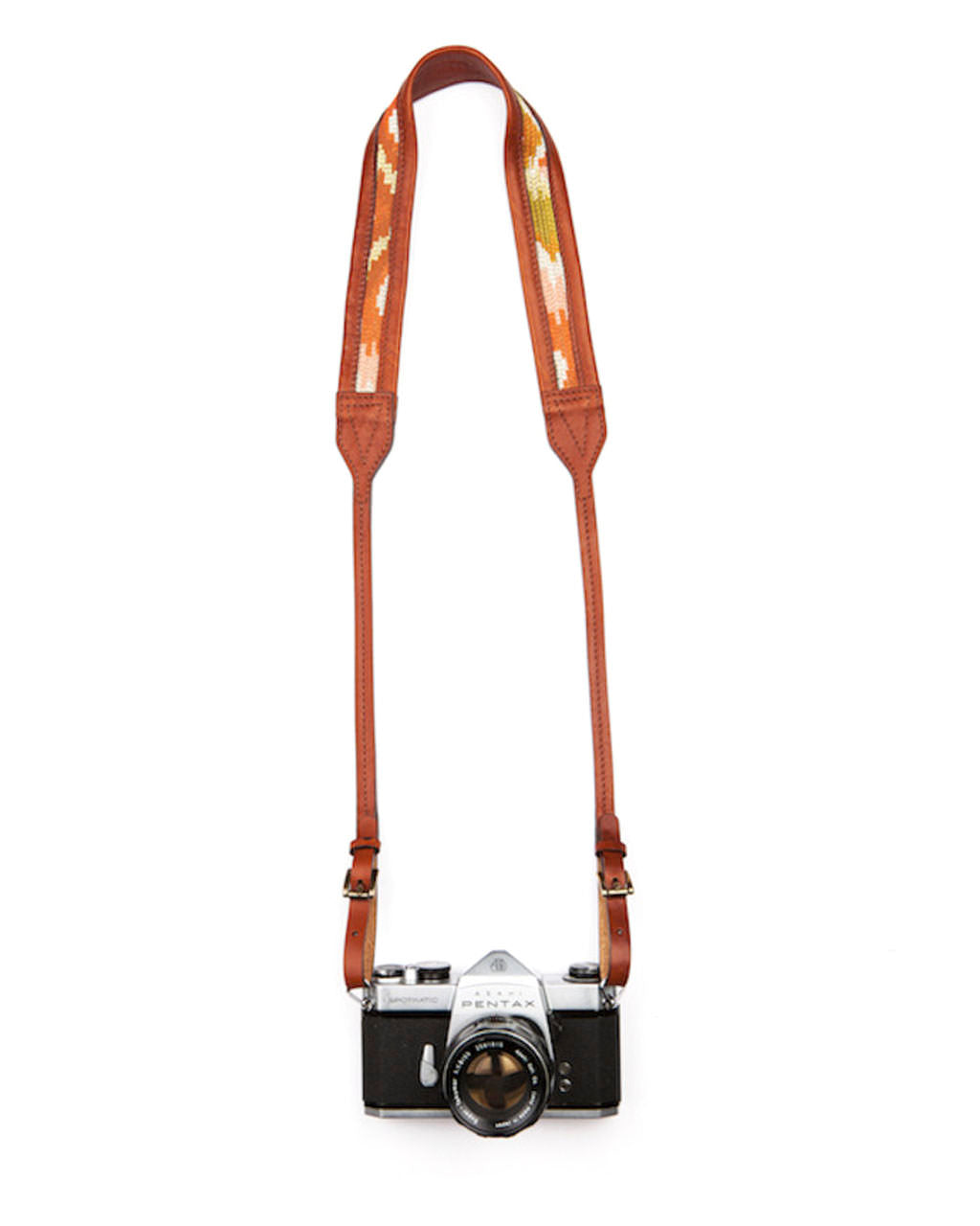 Camera with leather camera strap