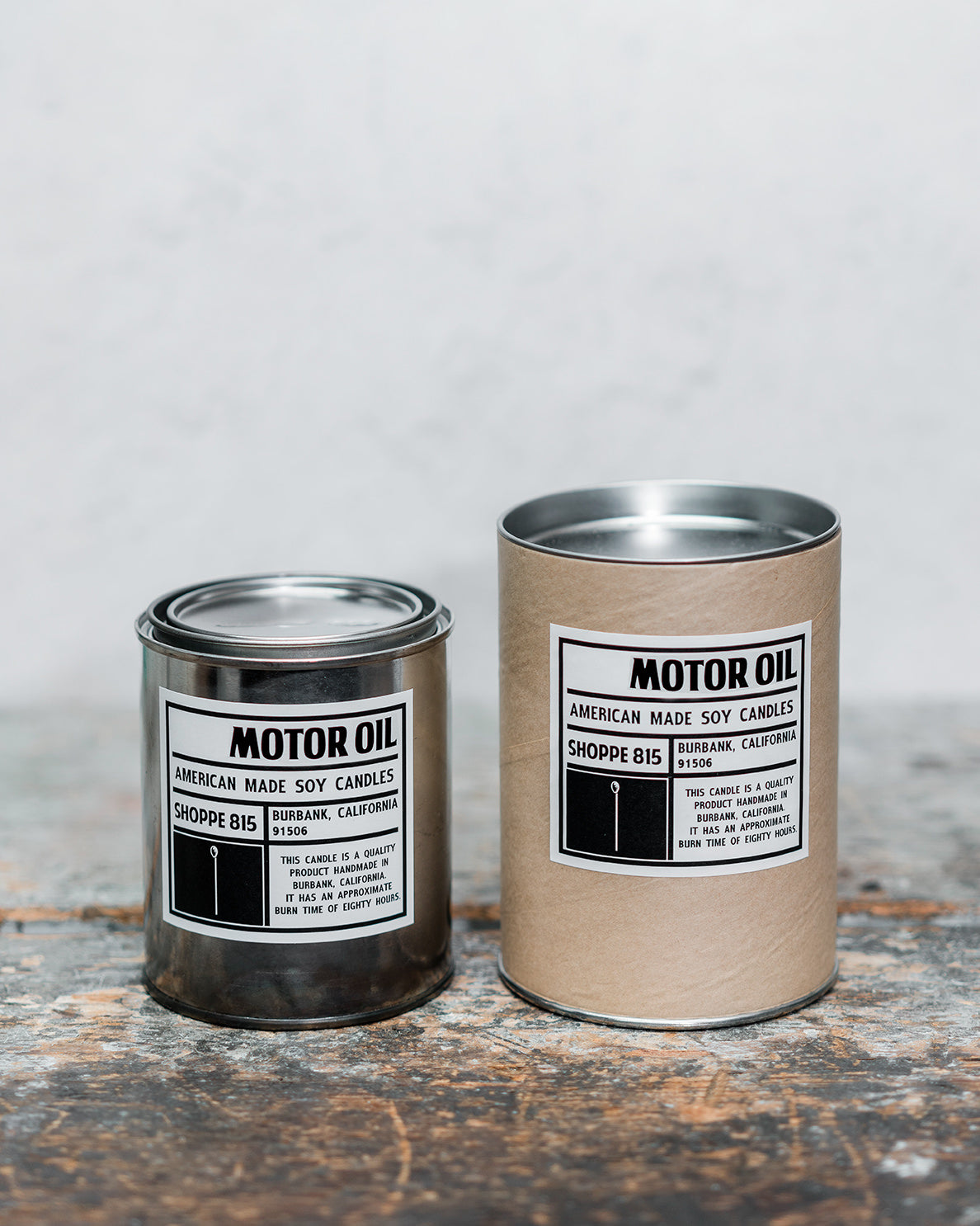 Motor Oil gender neutral tin candle on wooden shelf with packaging