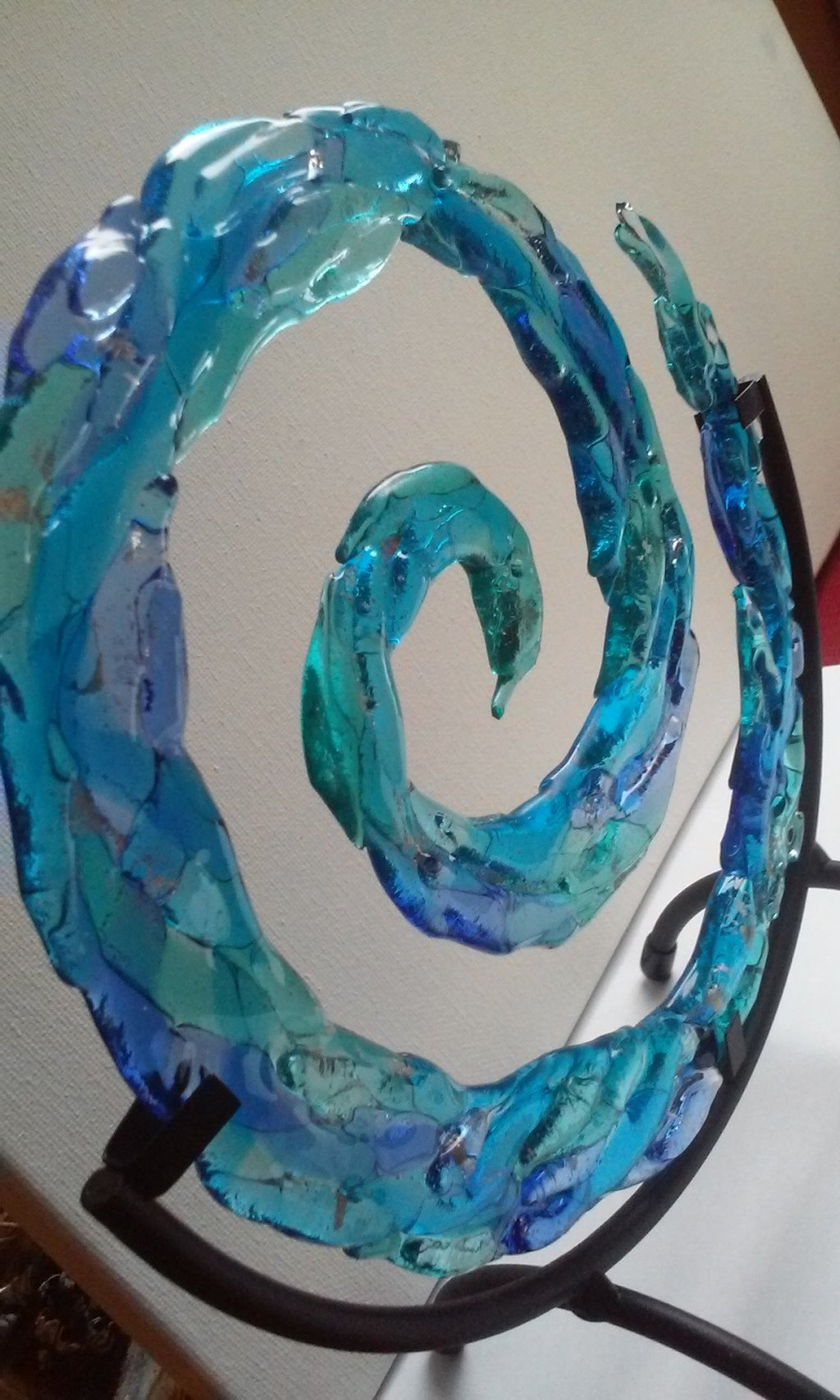 Ashes in Glass 3d Spiral of life in a 10 inch stand ashes infused glass cremation memorial urn by infusion glass side view