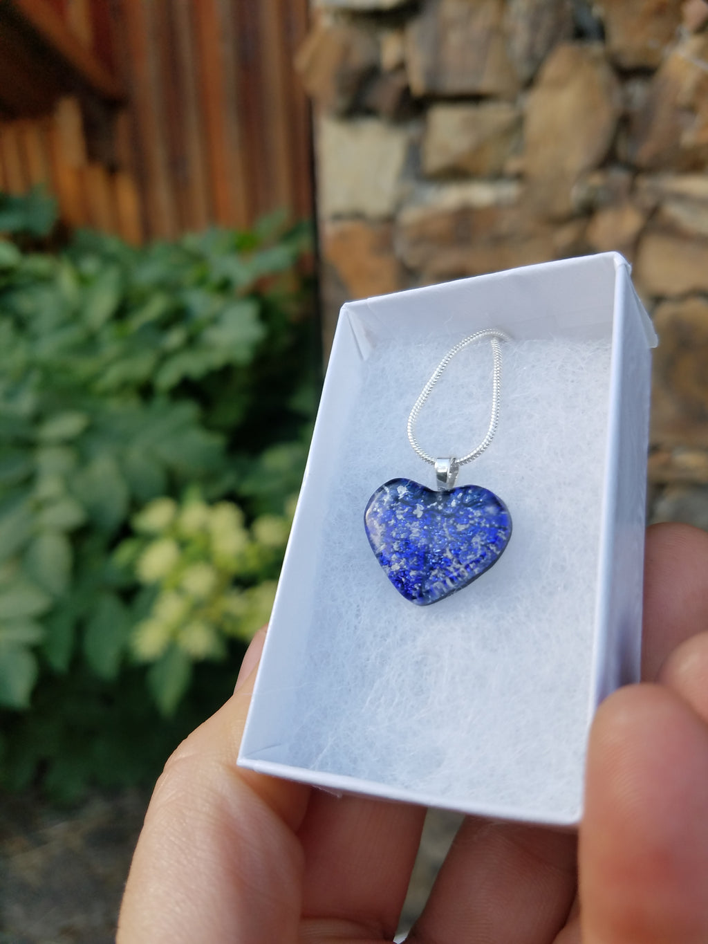 tiny cremation glass heart in a box in a hand Handmade Cremation Jewelry Pendants, Rings and Bracelets. Ashes in Glass Handmade . Sympathy Gifts, Mourning Jewelry. Cremation Ashes Infused in Glass. Quality Sterling Silver and 14k Gold USA Handmade by Infusion Glass  Human & Pet Cremation Ash Remembrance Urns