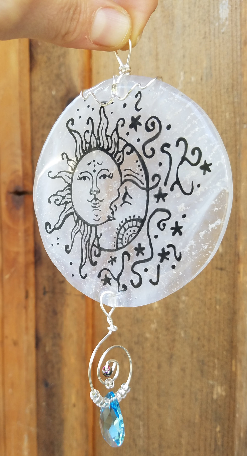 moon and sun suncatchr outside Celebration of life Funeral Memorials. Ashes in Glass Cremation Glass Art Sculptures, Cremation Wind Chimes, Cremation Sun Catchers, Table Displays, & Cremation Jewelry Custom USA Handmade by Infusion Glass. Ashes Infused Glass Human and Pet Cremation Ash Urns  Ashesinfusedglass.com