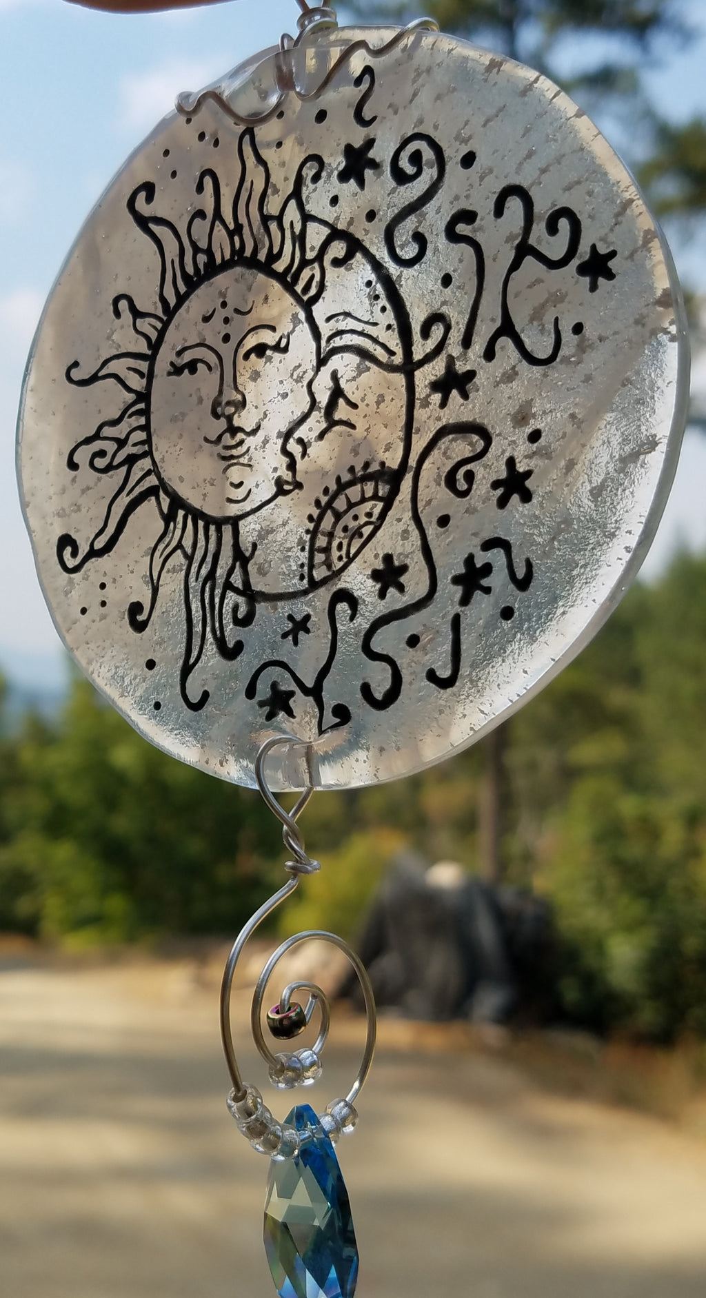 side view moon and sun sun catcher outside Celebration of life Funeral Memorials. Ashes in Glass Cremation Glass Art Sculptures, Cremation Wind Chimes, Cremation Sun Catchers, Table Displays, & Cremation Jewelry Custom USA Handmade by Infusion Glass. Ashes Infused Glass Human and Pet Cremation Ash Urns  Ashesinfusedglass.com