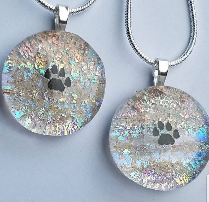 2 Tiny Paw print necklaces in Rainbow Clear Unique Pet Memorial Cremation Jewelry Ashes InFused Glass Handmade Cremation Memorial Glass Art,  Sympathy Gifts, Mourning Glass Art Service Cremation Ashes Infused in Glass. Quality Sterling Silver USA Handmade by Infusion Glass Artist Joele Williams Human and Pet Cremation Ash Remembrance Urns AshesInfusedGlass.com