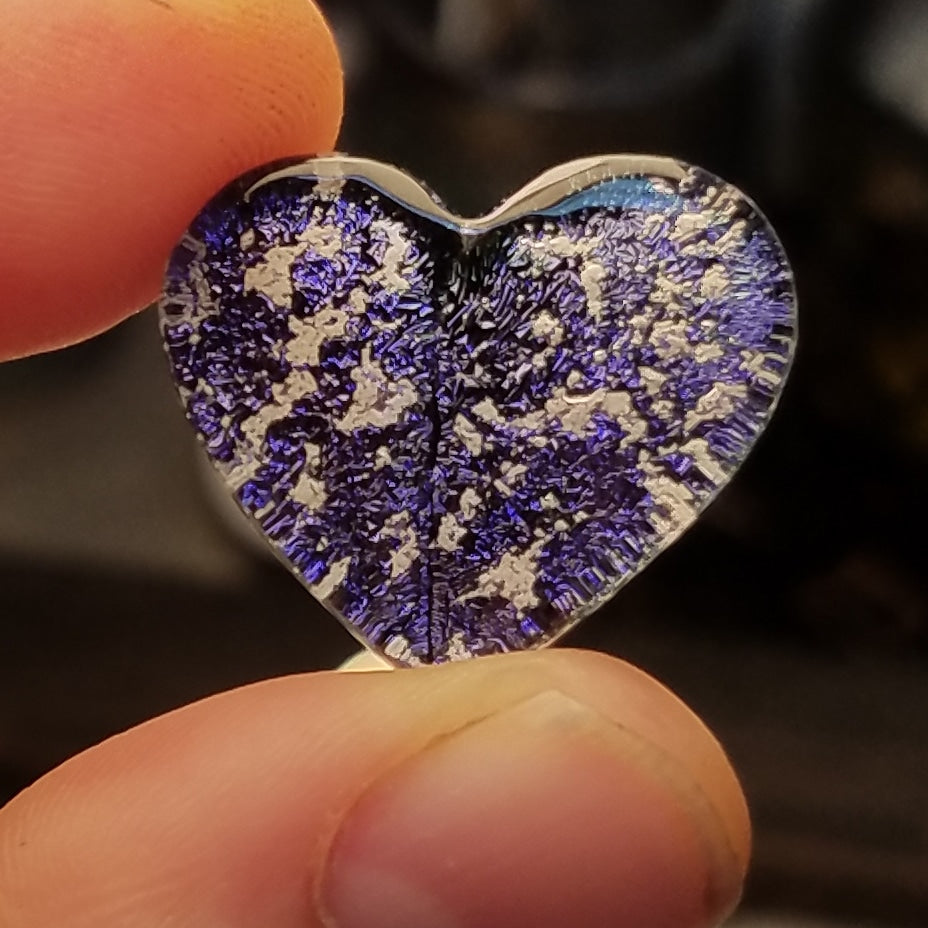 purple glass cremation heart in fingers Handmade Cremation Jewelry Pendants, Rings and Bracelets. Ashes in Glass Handmade . Sympathy Gifts, Mourning Jewelry. Cremation Ashes Infused in Glass. Quality Sterling Silver and 14k Gold USA Handmade by Infusion Glass  Human & Pet Cremation Ash Remembrance Urns