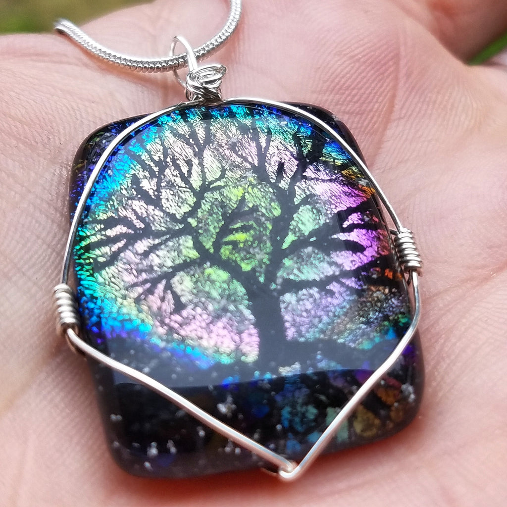 1 full moon tree of life pendant in a hand Unique Handmade Cremation Jewelry Pendants, Rings and Bracelets. Ashes in Glass Handmade . Sympathy Gifts, Mourning Jewelry. Cremation Ashes Infused in Glass. Quality Sterling Silver and 14k Gold USA Handmade by Infusion Glass  Human & Pet Cremation Ash Remembrance Urns AshesInfusedGlass.com