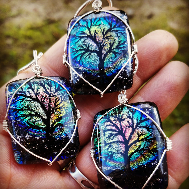 3 Full Moon Tree of Life Cremation Pendants in a hand Unique Handmade Cremation Jewelry Pendants, Rings and Bracelets. Ashes in Glass Handmade . Sympathy Gifts, Mourning Jewelry. Cremation Ashes Infused in Glass. Quality Sterling Silver and 14k Gold USA Handmade by Infusion Glass  Human & Pet Cremation Ash Remembrance Urns AshesInfusedGlass.com