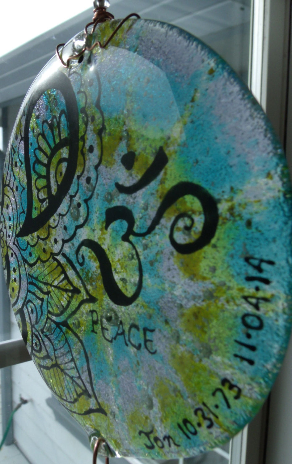 Ashes Infused Glass Cremation Art Sun Catcher OM Peace Memorial close up side view