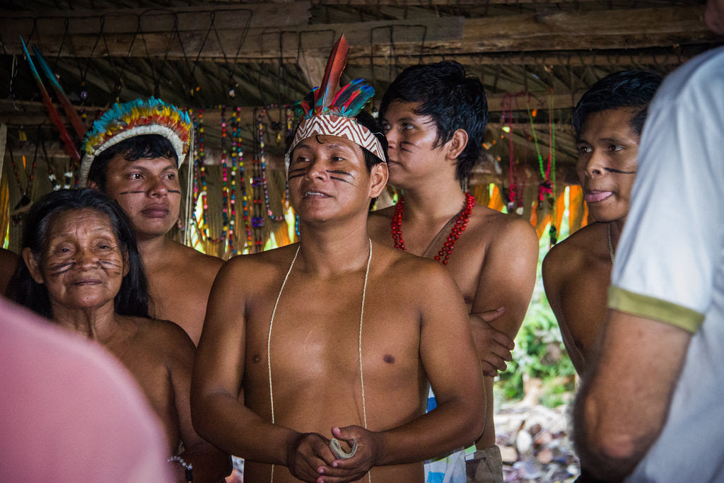 Group of South American Indigenous people in traditional dress