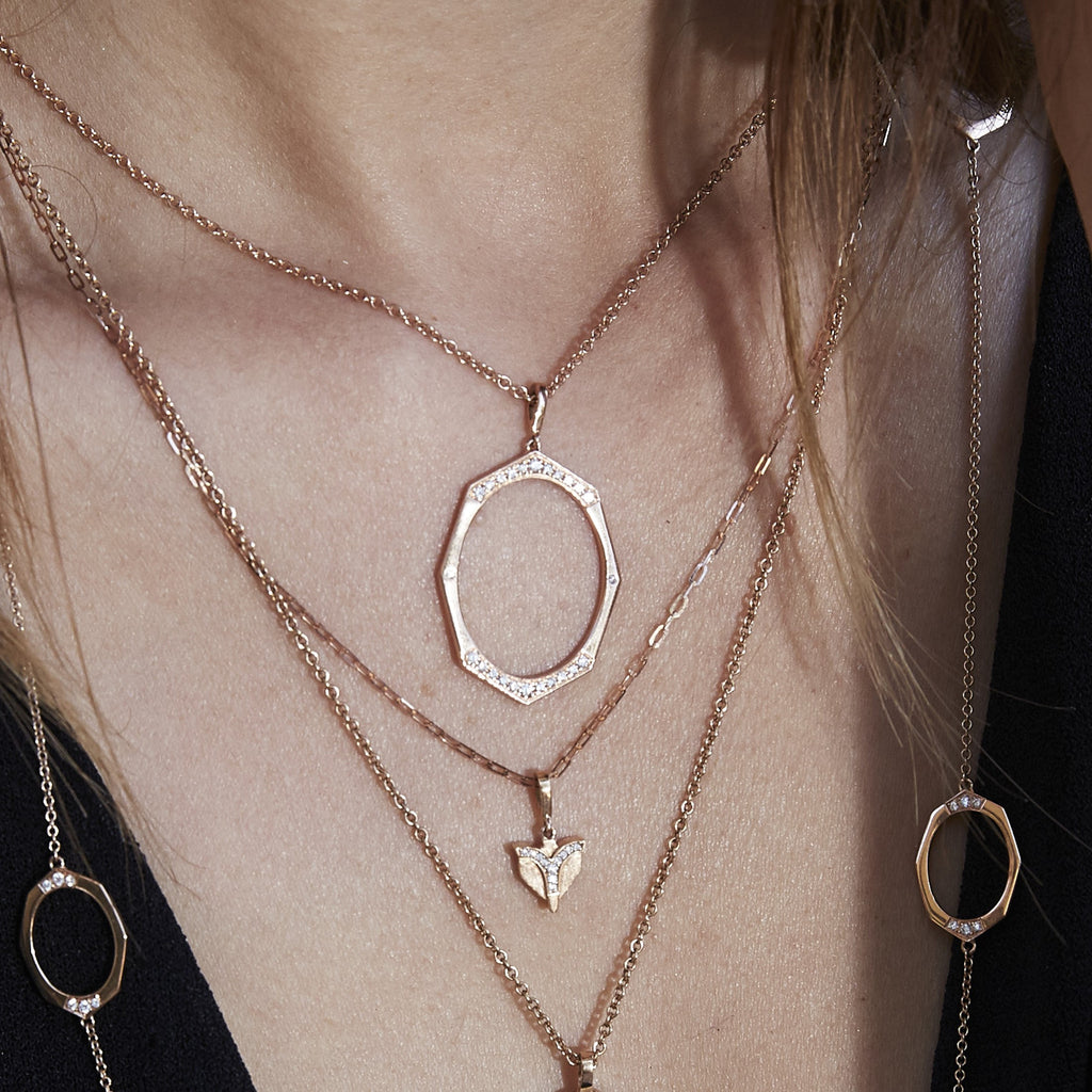 Large Diamond Pendant in Rose Gold By Irthly Displayed By Model 4