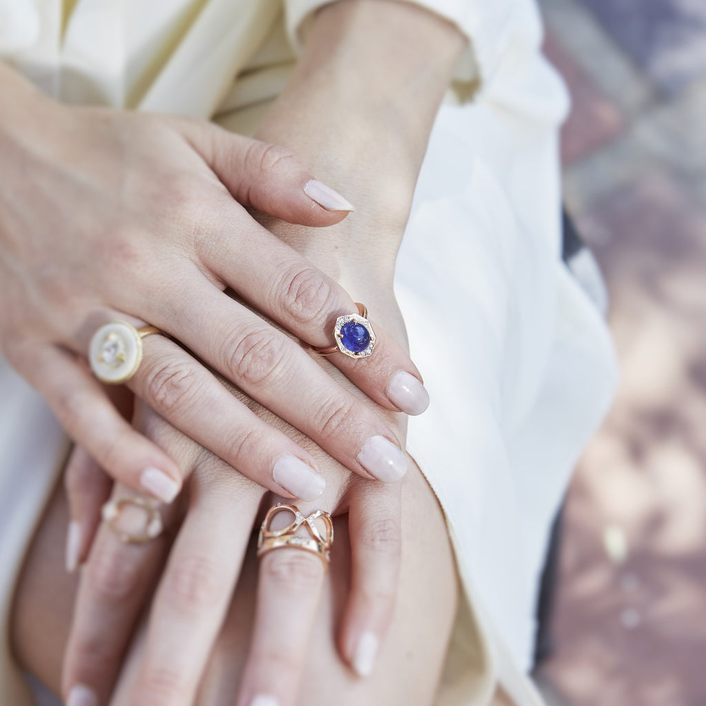 Tanzanite Ring With Diamonds in Rose Gold On Finger By Irthly