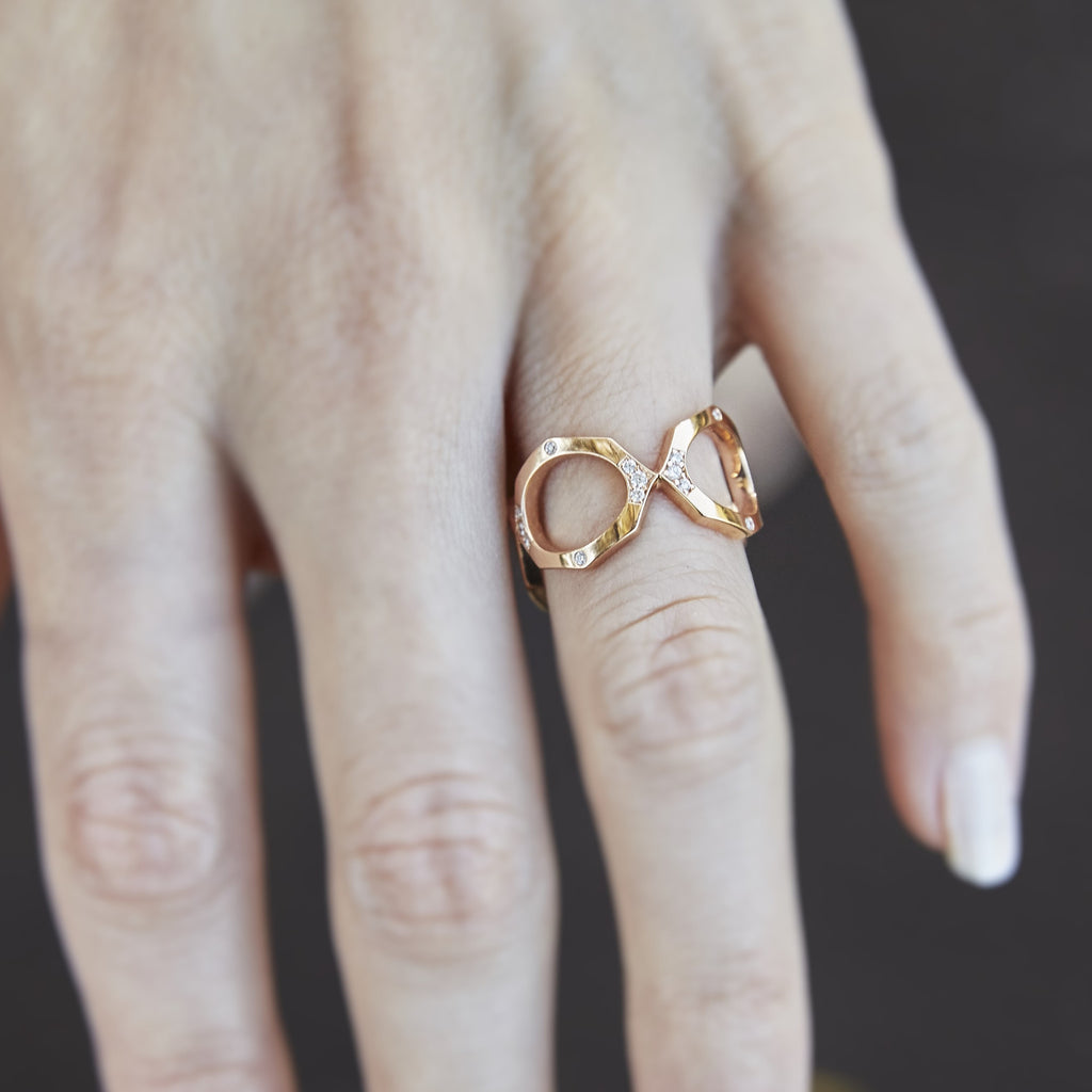 Diamond Eternity Ring Band in Rose Gold Displayed in Hand By Irthly