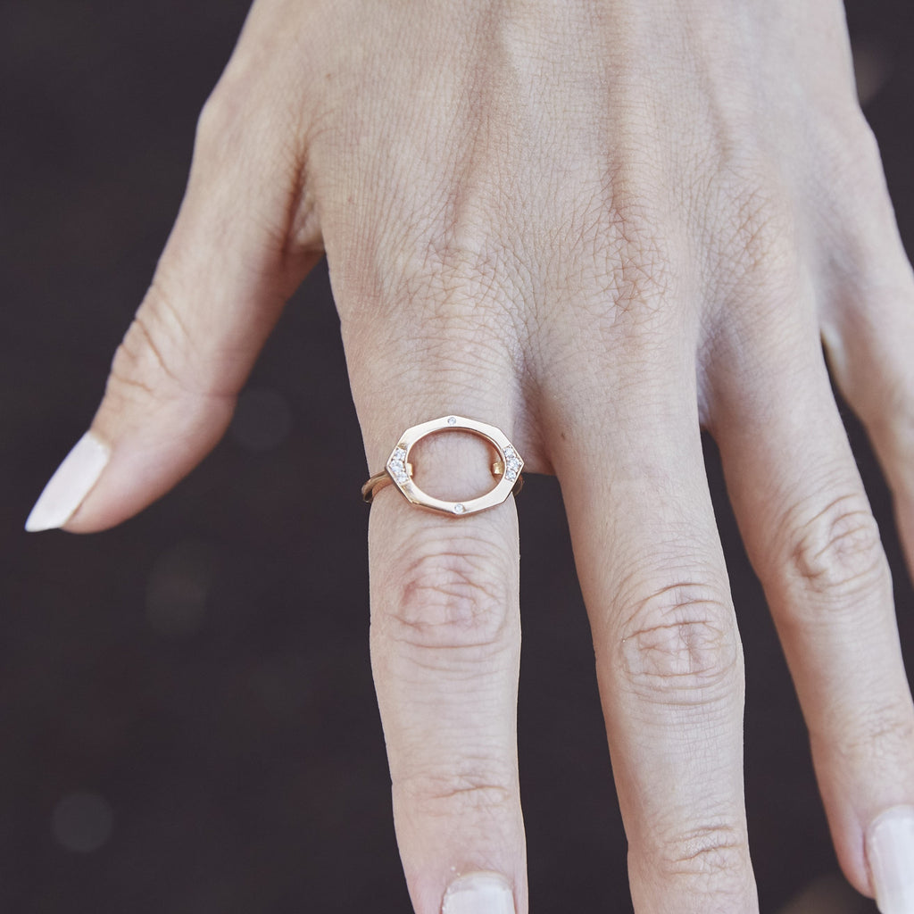 Small Oval Shaped Horizontal Diamond Ring in Rose Gold Displayed On Hand5 By Irthly