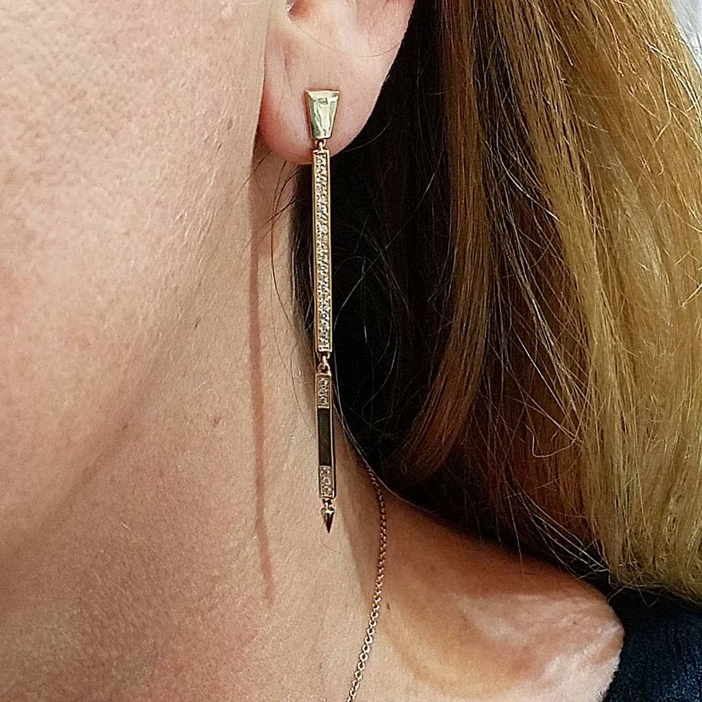 two tier bar drop earrings in yellow gold on ear of model | Irthly Sans | Irthly