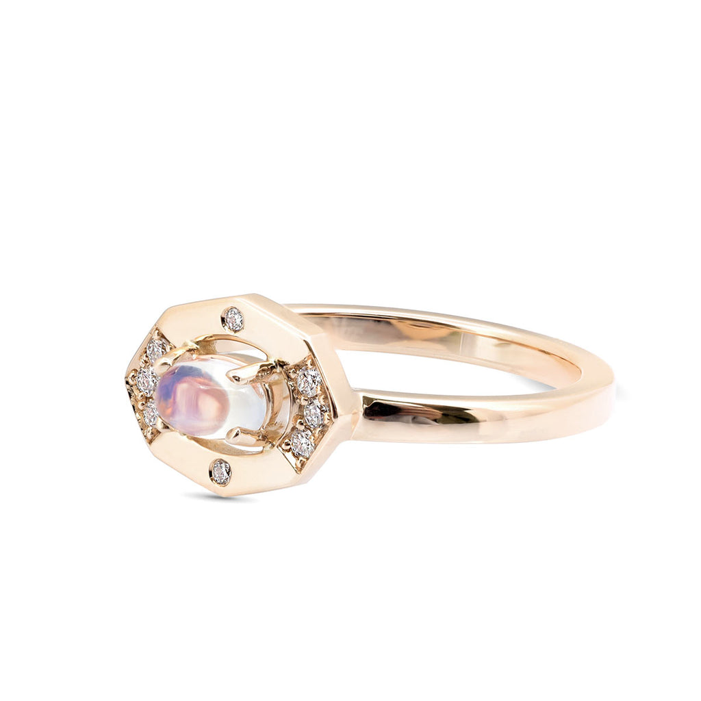 Dainty Moonstone and Diamond Vertical Ring displayed in yellow gold